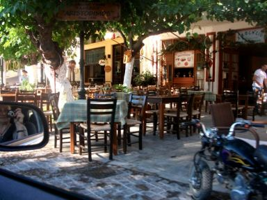 There are no sidewalks in Greece, just sidewalk cafes