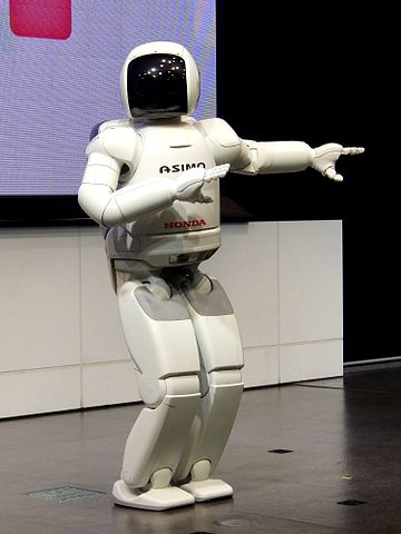 http://commons.wikimedia.org/wiki/File:ASIMO_2011_model_dancing.jpg