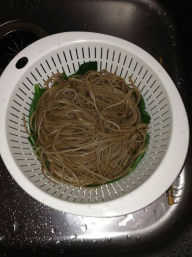 Cook your soba and wilt the greens first